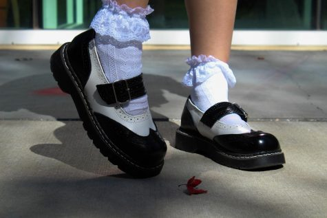 Senior Izzy Bryars wearing a pair of her Doc Martens Sept. 30. Bryars said she likes the shoes because they remind her of old school girl shoes and loves to wear them with curly white socks. photo by Josie Fox