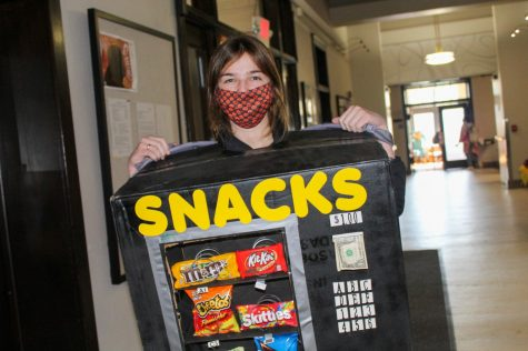 Junior Sophia Beshoner wears a vending machine costume Oct. 30. Beshoner created the costume out of household items, with the help of her mom. photo by Katie Massman