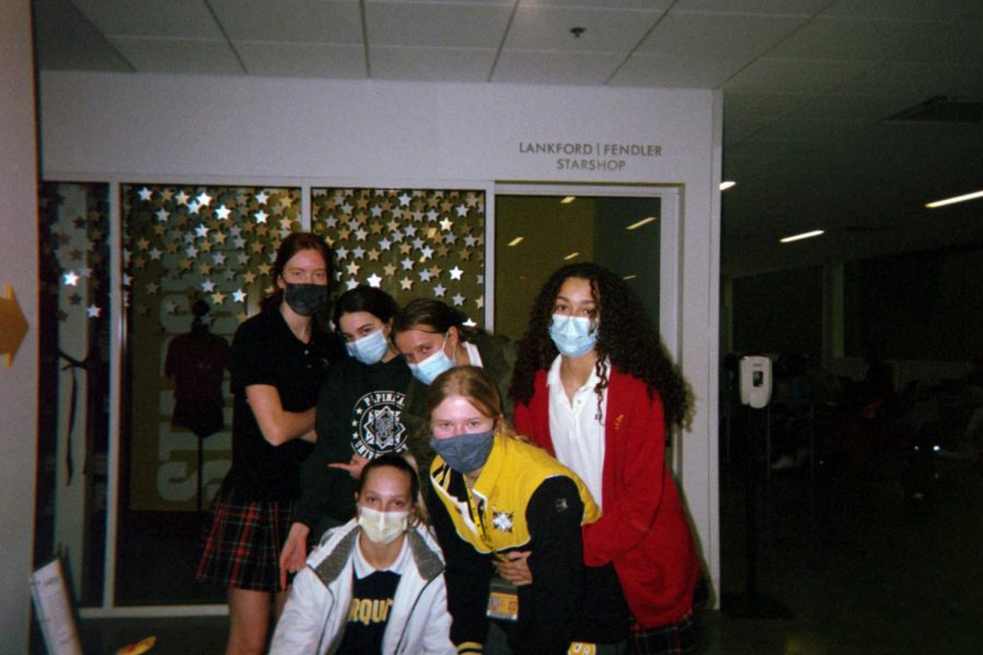 A group of seniors pose for a photo in front of the Star Shop Jan. 28. After taking a photo, students were asked to disinfect the camera to maintain COVID-19 precautions.