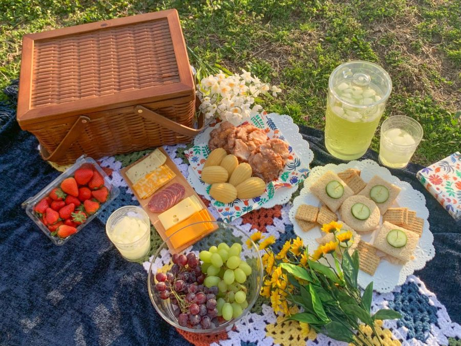 Bouquets of flowers are laid around the picnic spread April 4. The fresh flowers and warm weather of spring can be enjoyed at a picnic.