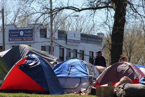 Multicolored tents for the homeless sit in the intersection of Westport road and Southwest Trafficway April 1. According to organizers, this encampment is meant to be a constant reminder to the public until city leaders start addressing Kansas City