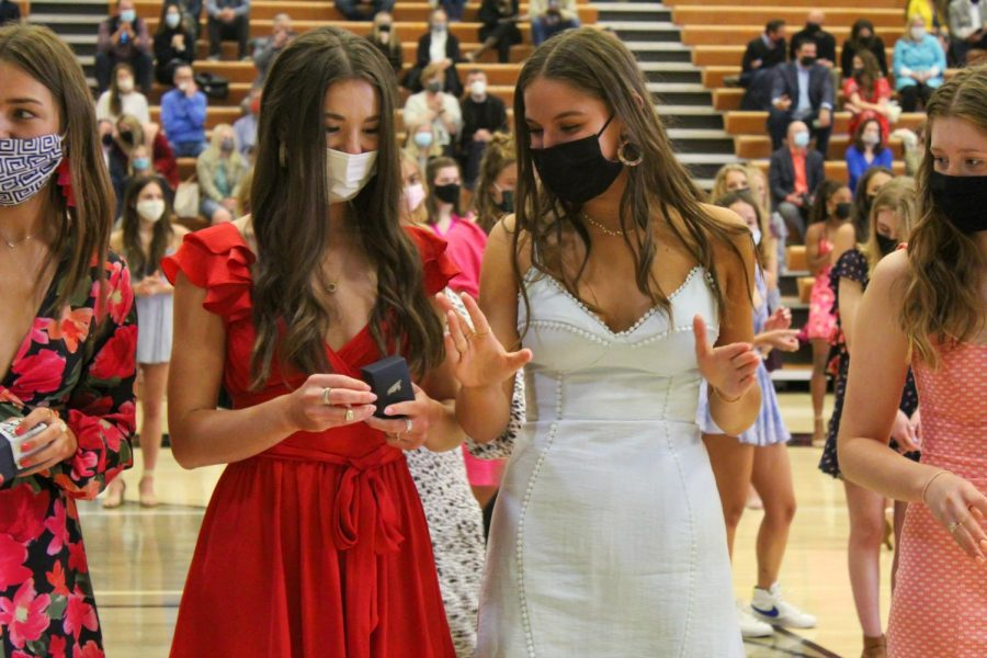Junior Sam Begnaud admires a junior Ellie Batliner's new ring during the Junior Ring Ceremony April 17. The ceremony was held from 5-6 p.m. and the dance from 6:30-7 p.m.. photo by Carmon Baker