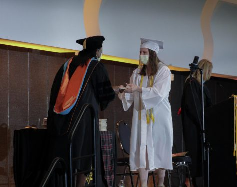 Senior Eileen Harrington crosses the stage to accept her diploma from school president Siabhan May-Washington May 15. Graduation took place in the Kansas City Convention Center. photo by Ellie Buttell