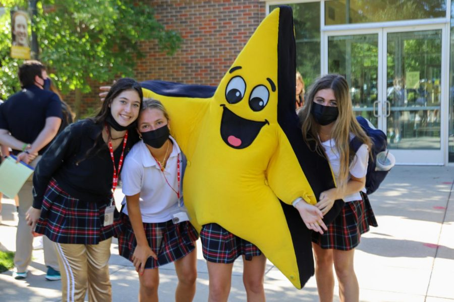 Juniors, from left, Bella Stockwood, Sarah Schloegel and Emma Mullins pose with Twinks. All three girls are members of Spirit Club. photo by Charlotte Malone