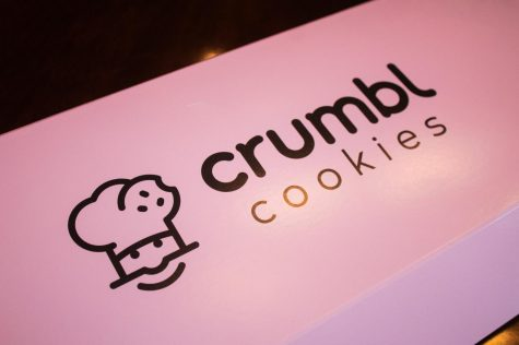 The cookies from Crumbl come in this well-known pink box Aug. 30. Due to the cookies' popularity on social media, people have labeled the box iconic. photo by Lily Sage